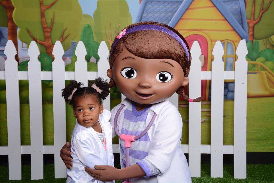 Little Black Girl with Doc McStuffins Character