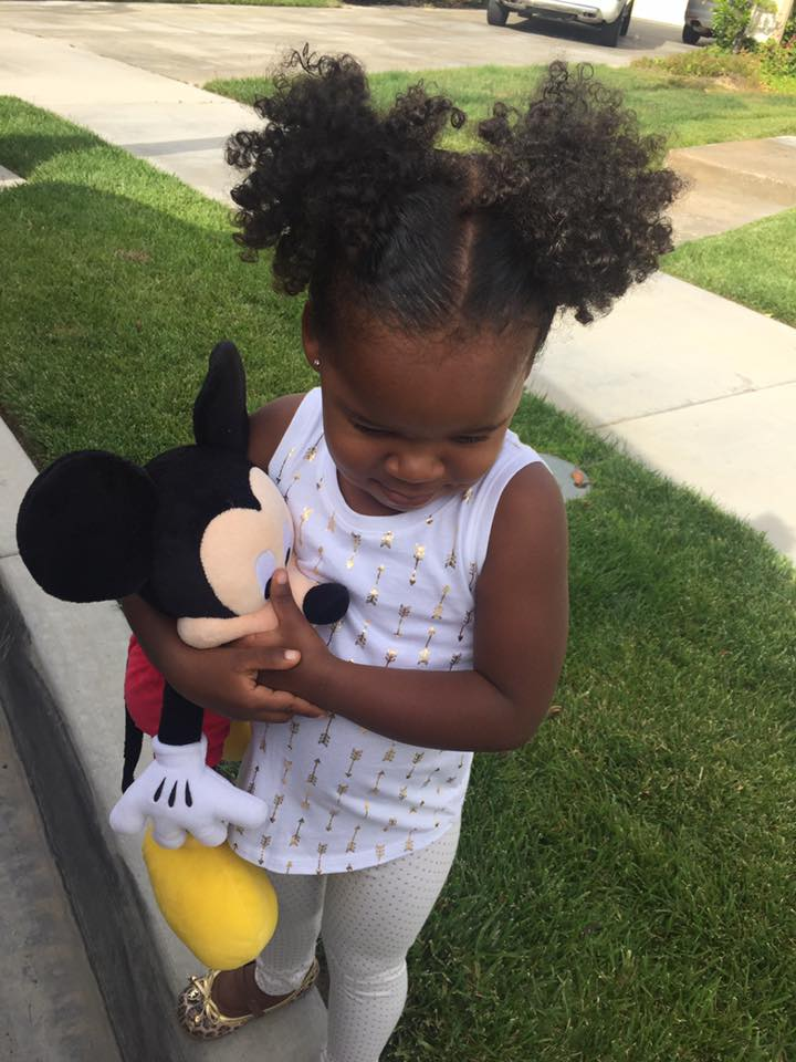 Black girl with her Mickey Toy