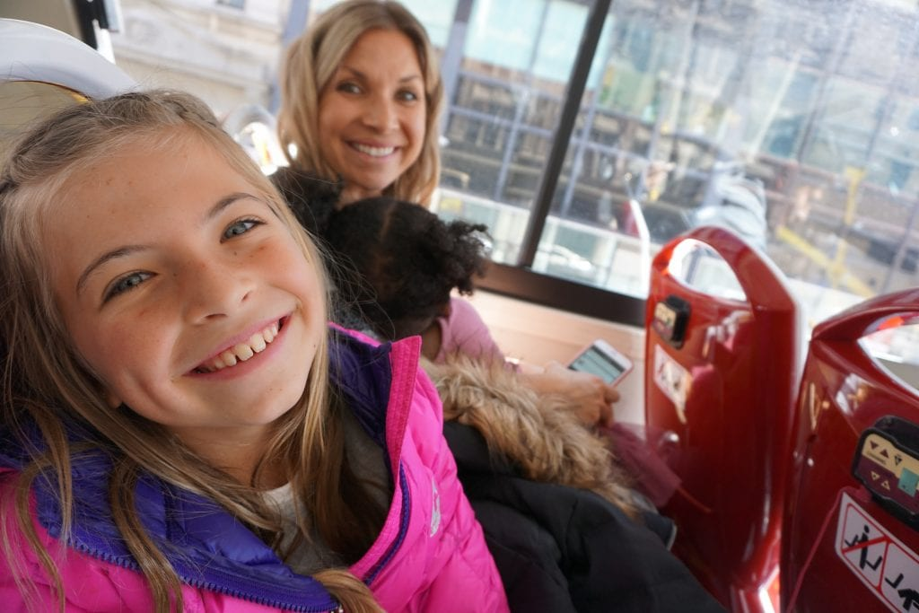 Little girl and mother on top deck of a Big Bus Tours NYC | Global Munchkins