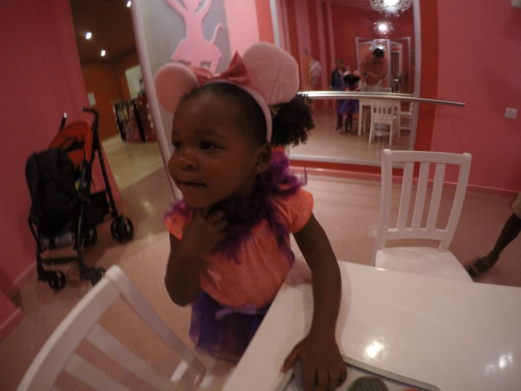 Little black girl playing in the Angelina room at the Little Big Club Hard Rock Cancun