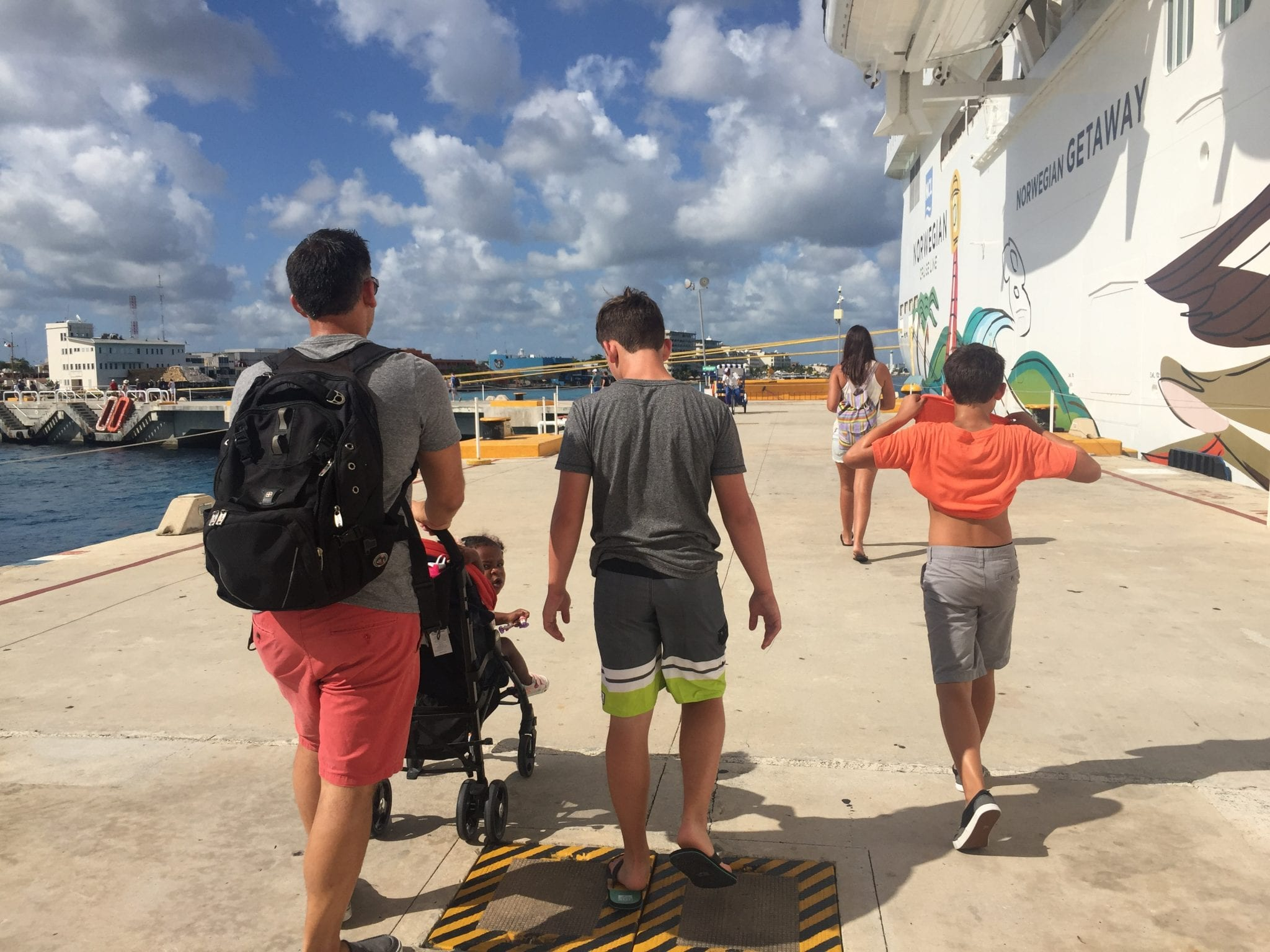 family getting off the cruise ship in port at Cozumel