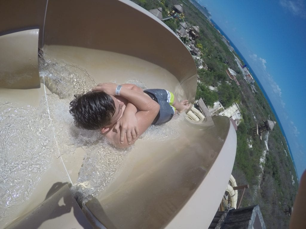 Boy going down insane waterslide at Maya Park- lost Mayan kingdom in Costa Maya Mexico. Great shore excursion.