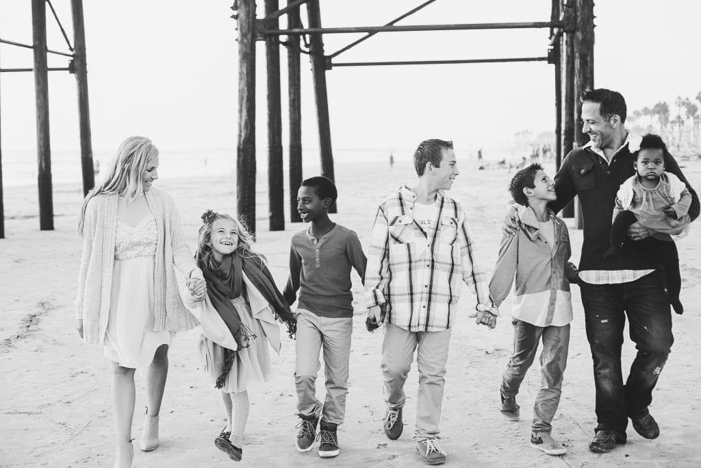 Transracial adoptive family Family walking on beach   Global Munchkins