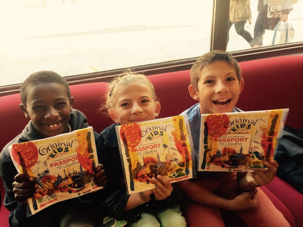 Kids waiting to board the Original Tour in London with their complimentary kids books | London with Kids | Global Munchkins