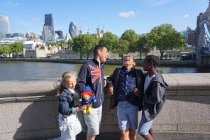 Laughing kids with Tower of London in Background | London with Kids | Global Munchkins
