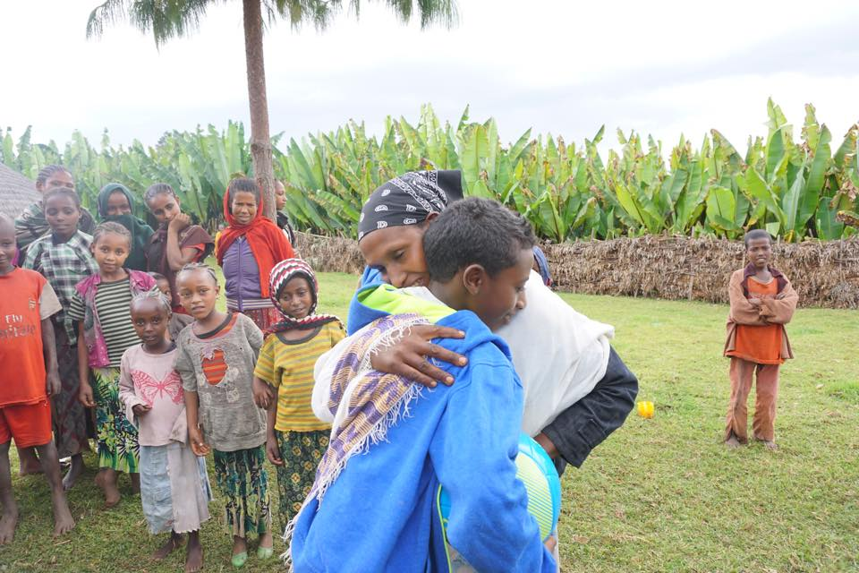 My son embracing his biological mom after being reunited in Ethiopia