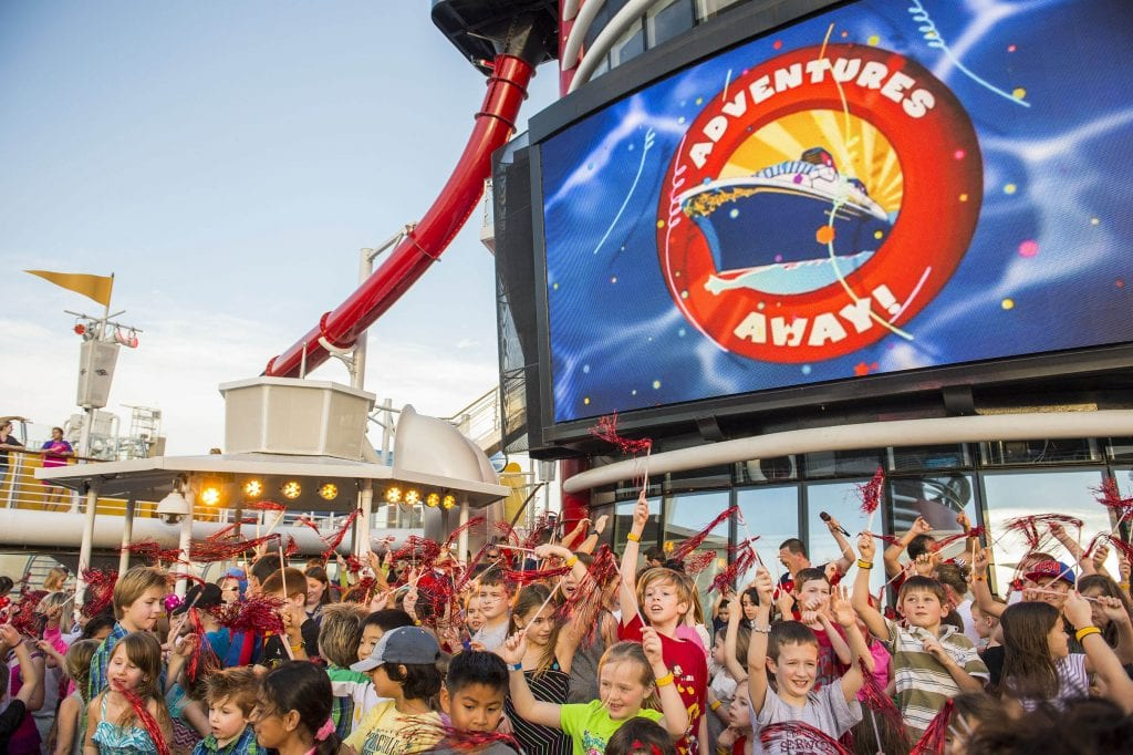 """Adventures Away,"" an extra-special celebration on the upper decks, signals the official start of magical vacation on the Disney Magic. Deck parties aboard Disney Cruise Line are designed to entertain all ages with high-energy music, dancing, special effects and appearances by the Disney characters. (Matt Stroshane, photographer)"