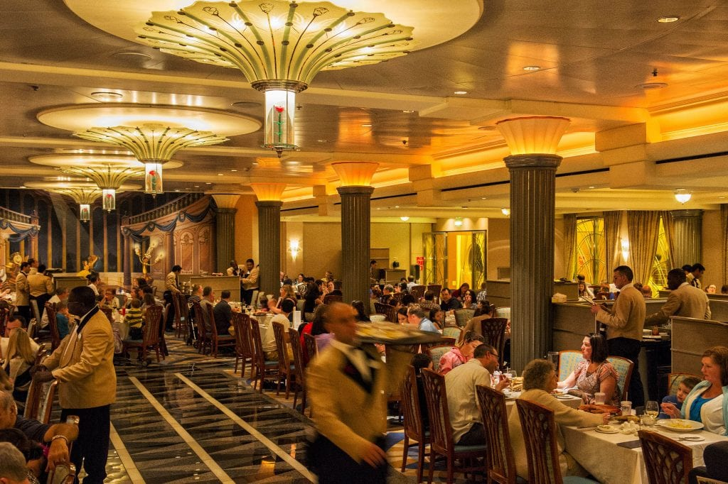 "Lumiere's on the Disney Magic resembles a grand dining room aboard a classic transatlantic ocean liner. The design features rose-petal chandeliers and theming from Disney's ""Beauty and the Beast,"" adding a little French flair and providing a magical night of dining and romance. (Matt Stroshane, photographer)"