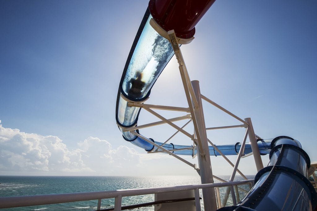 AquaDunk on the Disney Magic is a thrilling new three-story body slide that begins with a surprise launch when the floor beneath guests' feet opens like a trap door. The drop sends them on an exhilarating, swift and splashy ride in a tube that extends 20 feet over the side of the ship. (Matt Stroshane, photographer)
