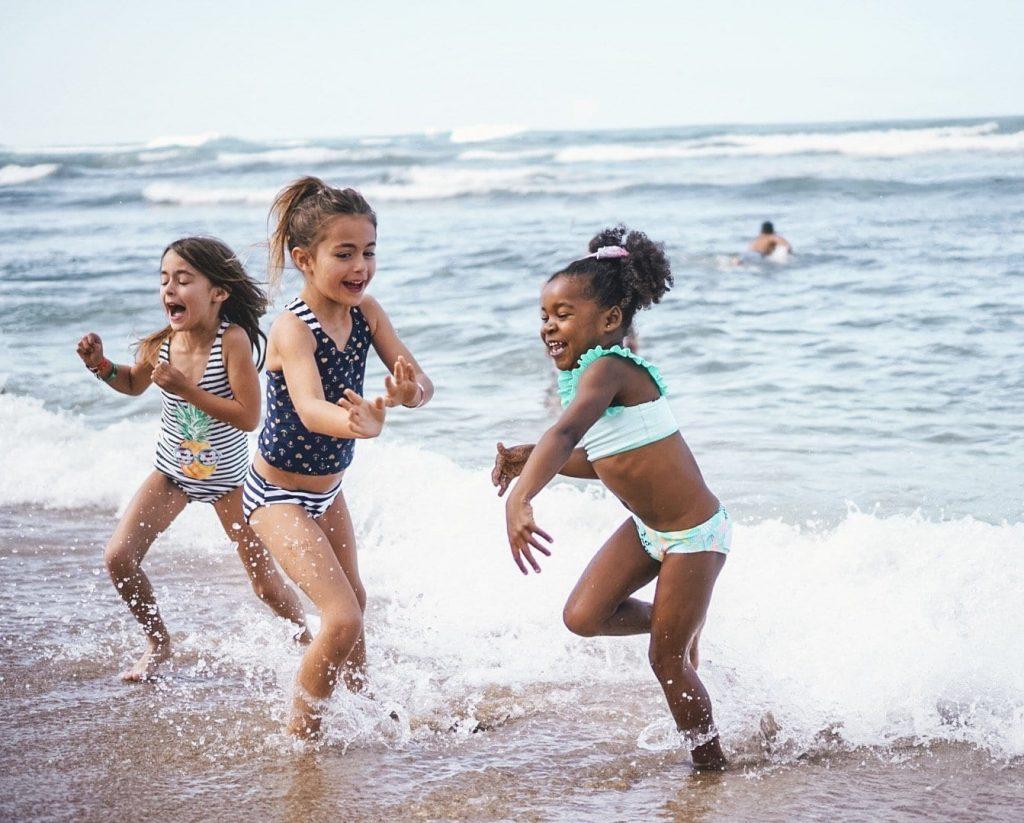 Kids Playing At North SHore Oahu Beach