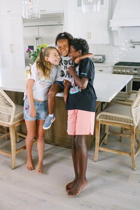 Adoptive family in gorgeous white kitchen