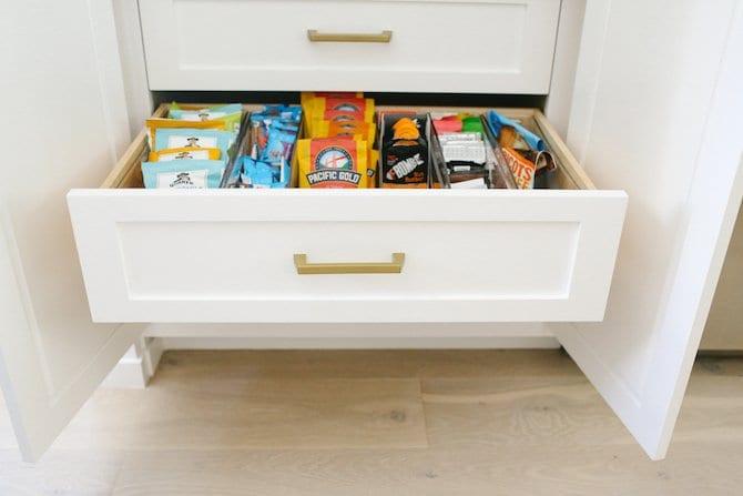 Custom White Kitchen with snack drawer. Kitchen Organization.