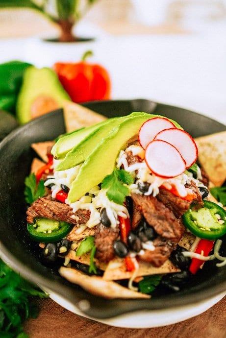 gorgeous cast iron skillet with steak keto nachos