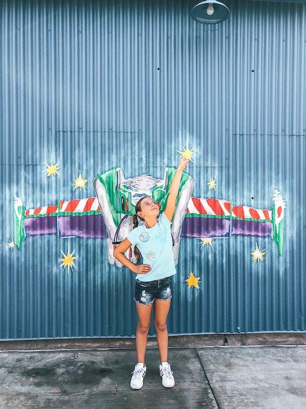 Disneyland tips - take pictures in front of fun Disneyland Walls